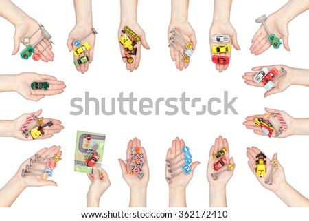driving school concept. collection of many hands holding road signs and cars isolated on white background - stock photo