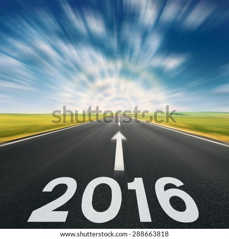 Driving speed on an empty road in blurred motion at lovely sunny day to meet the new 2016 year. - stock photo
