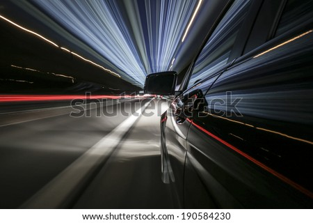 driving super fast on german autobahn , bulb exposure, rigged camera on left side of a german black car during night - stock photo