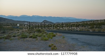 Driving the Valley of fire highway as dusk settles in - stock photo