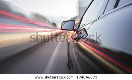 driving through Munich, during day, rigged camera on the side of a german black car, bulb exposure - time-lapse, special effects photography