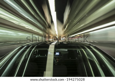 driving through Munich, during night, rigged camera on the rear/trunk of a german black car, bulb exposure - time-lapse, special effects photography - stock photo