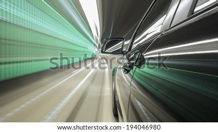 driving through Munich, during night, through a city-tunnel, rigged camera on the side of a german black car, bulb exposure - time-lapse, special effects photography - stock photo