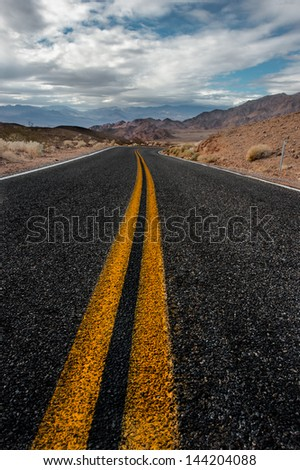 Driving through the death valley highway - stock photo