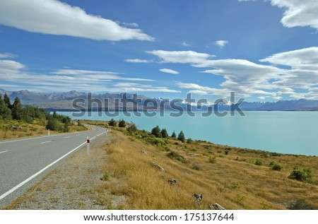 Driving towards Mount Cook and the Southern Alps, South Island, New Zealand - stock photo