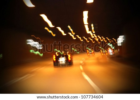driving under the influence of alcohol in a tunnel - stock photo