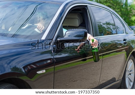 Driving Under the Influence. Woman sleeping on the steering wheel. - stock photo