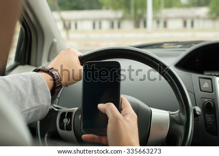 Driving with a mobile phone in hand