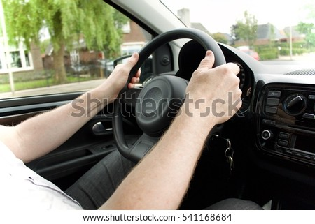 Driving with both hands on the steering wheel