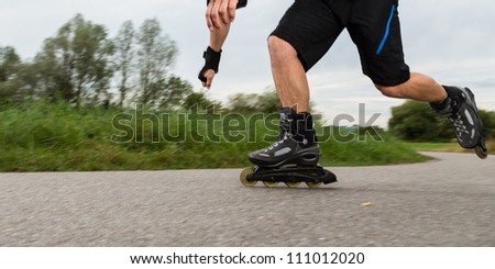 driving with roller blades - stock photo