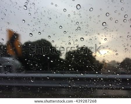 Drizzle on the glass in the rain , rain , fog , mirrors, sun - stock photo