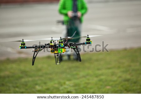 Drone being flown in an urban area - stock photo