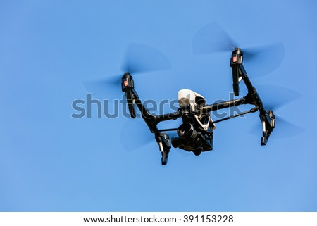 Drone flying against blue sky background