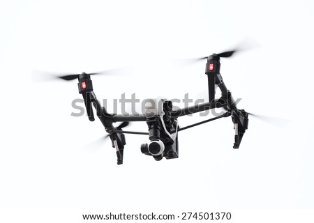 drone flying in white background, from below angle - stock photo