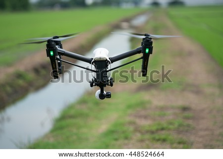 Drone is flying above the rice field and water bank - stock photo