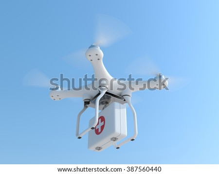 Drone quadcopter carrying first aid kit for fast emergency medical care  - stock photo