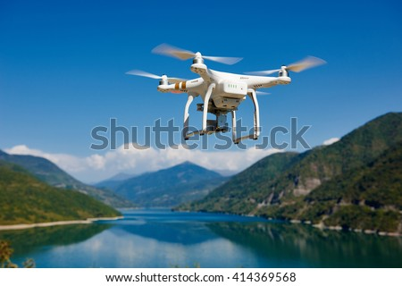 drone quadrocopter with digital camera - stock photo