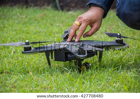 Drones parked on the grass. Drones are flying test.