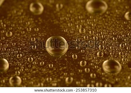 Drop of water on dark background  - stock photo