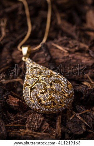 Drop shaped pendant with small rhinestones