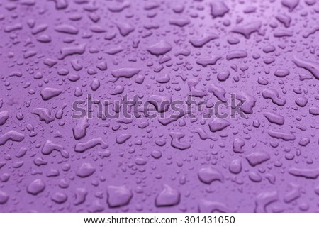 Drop water rain on the purple car in close up background and textures - stock photo