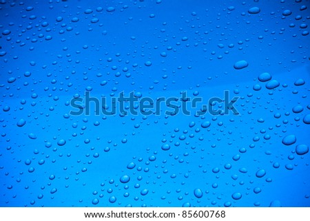 Droplets on a blue metal plate