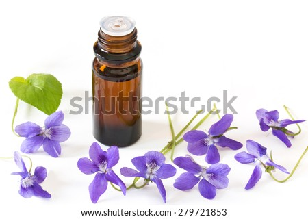 Dropper bottle of bach flower essence on white background with blossoms