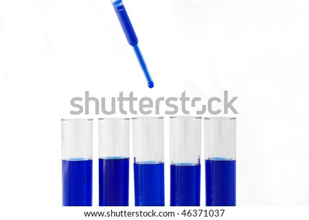 Dropper with blue drip and test tubes over white background - stock photo