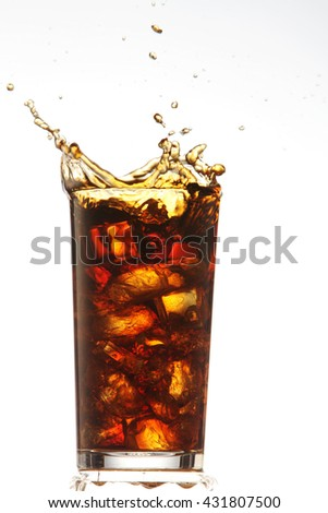 dropping a ice cube to a cola drinks