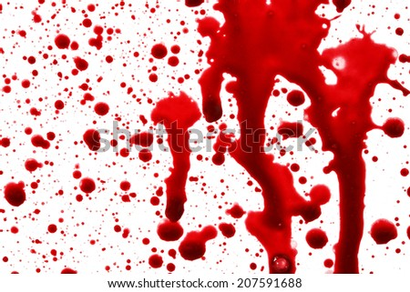 Drops of blood in front of a white background
