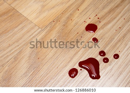 Drops of blood on laminate floor texture - stock photo