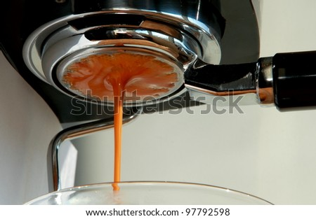 drops of fresh coffee converging into a single drop - stock photo