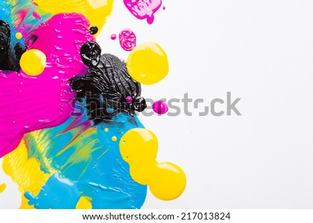 Drops of ink on white background - stock photo