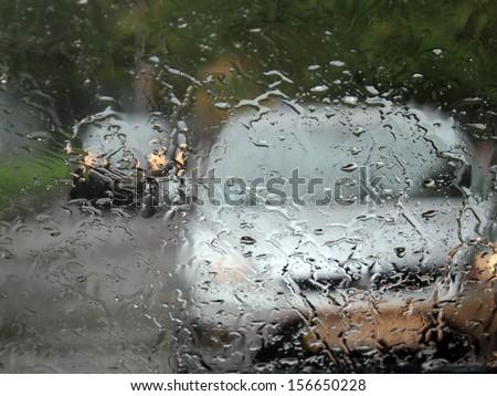 drops of rain on a car window pane  - stock photo