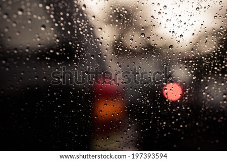 Drops of rain on car's mirror upon traffic jam. - stock photo