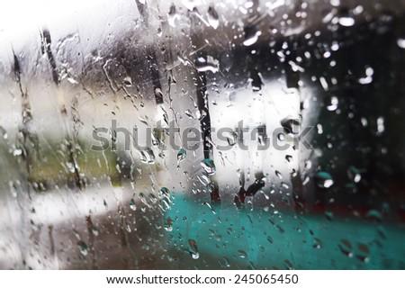 Drops of rain on glass. - stock photo