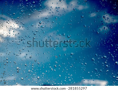 Drops of rain on glass on a cloudy evening