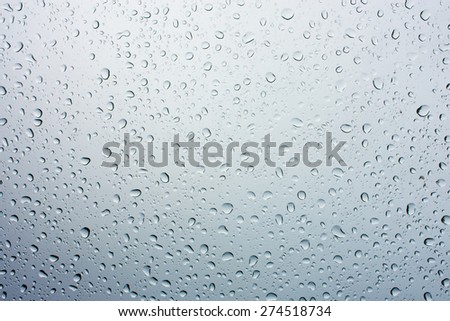 Drops of rain on glass , rain drops on clear window - stock photo