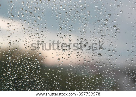 Drops of rain on the window (glass). Shallow DOF. - stock photo