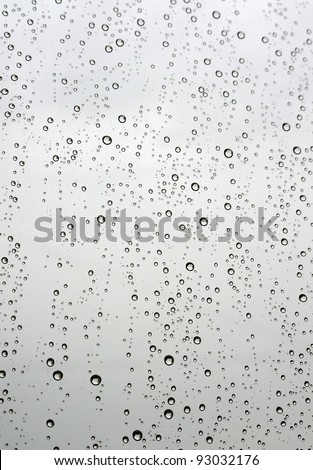 Drops of rain on the window (glass). Shallow DOF. - stock photo