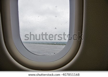 Drops of rain on the window of the plane