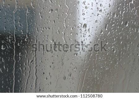 Drops of rain water glass - stock photo