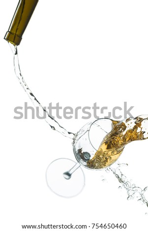 Drops of spray streams of wine and a glass on a white background