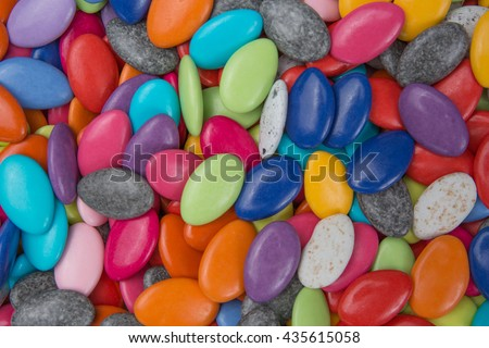 Drops of the candies coated chocolate. Various colors - stock photo