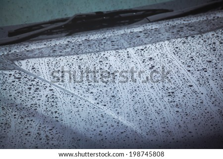 drops of water from rain on the car - stock photo