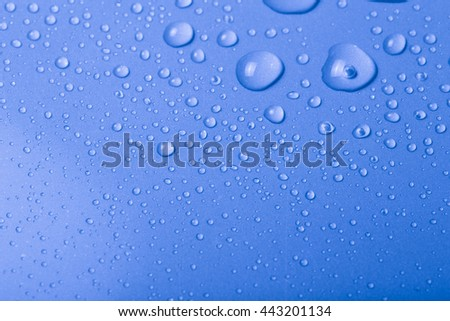 Drops of water on a color background. Blue. Shallow depth of field. Selective focus. Toned.