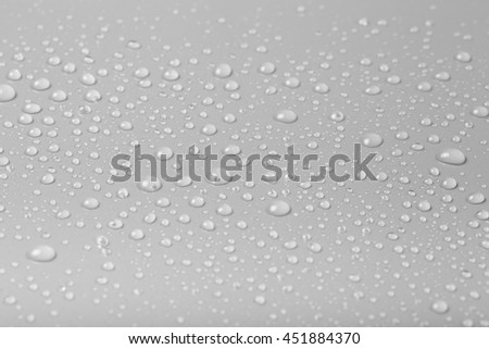 Drops of water on a color background. Gray. Shallow depth of field. Selective focus.