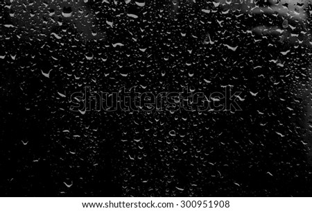 drops of water on a dark glass - stock photo