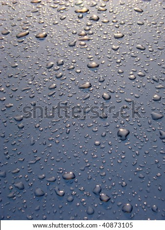 Drops of water on a surface of the car after a rain.