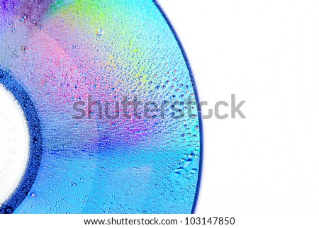 Drops of water on DVD - stock photo